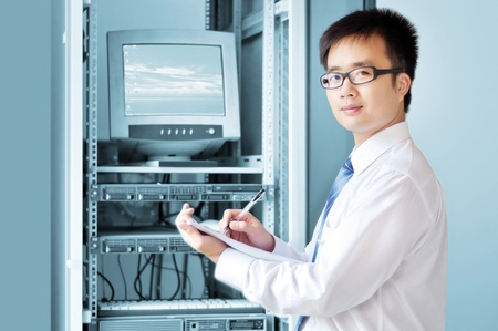 telco: it engineer  work is being seriously  Stock Photo