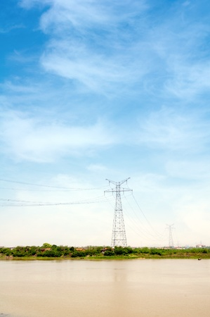 Electricity pylon against blue cloudy sky Stock Photo - 13638574