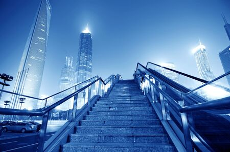 financial world: Shanghai streets of stairs and escalators, skyscraper buildings. Stock Photo