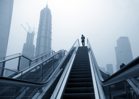 overbridge: Escalator of Shanghai streets, skyscraper buildings.