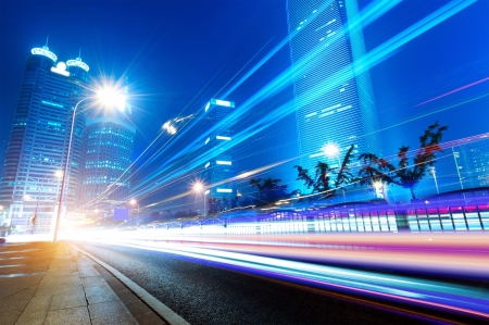 The light trails on the modern building background in shanghai china. Stock Photo - 14303049