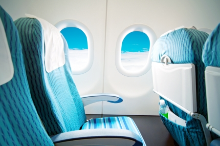 stewardess: Empty aircraft seats and windows. Stock Photo