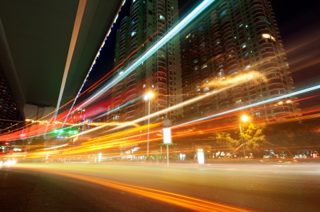 The light trails on the modern building background in shanghai china. Stock Photo - 14597336