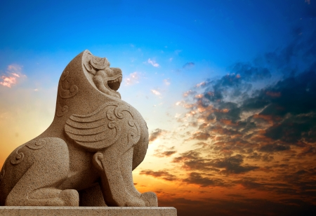 chinese culture: Traditional Chinese stone lions, Bund in Shanghai before the old building  Stock Photo