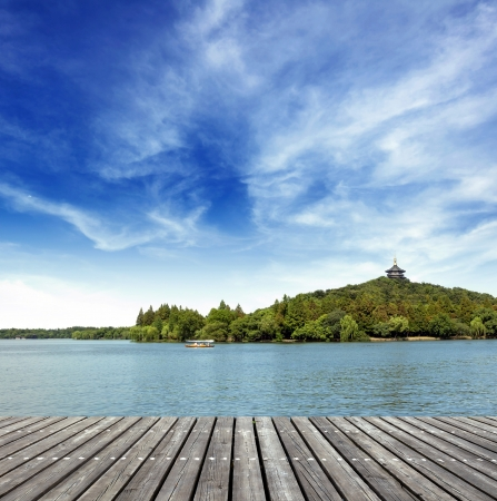 lake beach: The wooden structures of offshore platforms Stock Photo