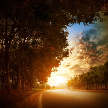 way to freedom: At dusk highway in the village  Stock Photo