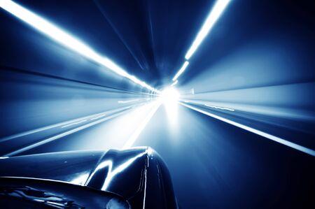 Car driving fast down interior tunnel  photo