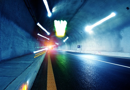 Abstract speed motion in urban highway road tunnel, blurred motion toward the central. Shot from a slow moving car photo