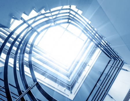 architectural interior: Sleek metal spiral staircase, modern architectural interior decoration.