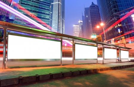 billboard blank: Blank billboard on bus stop at night Stock Photo