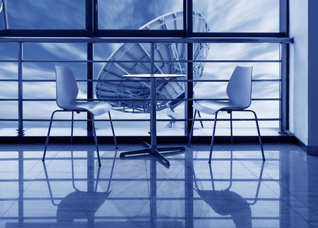 roundtable: The large windows of the office, out of the window of the dish.