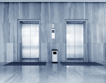shiny floor: Two lifts in a hotel hall Stock Photo