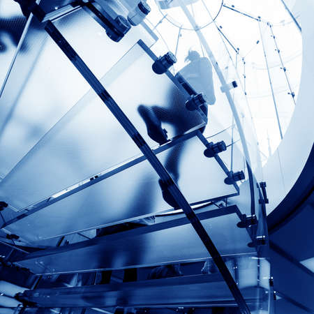 modern glass spiral staircase in shop with motion step Stock Photo - 16309368