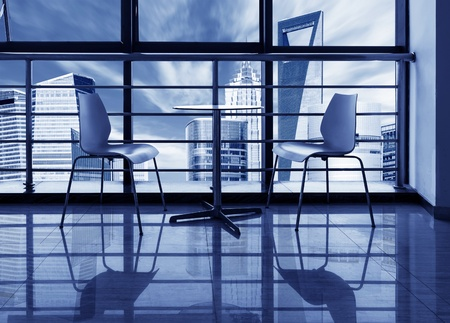 roundtable: The large windows of the office, out of the window of a skyscraper  Editorial