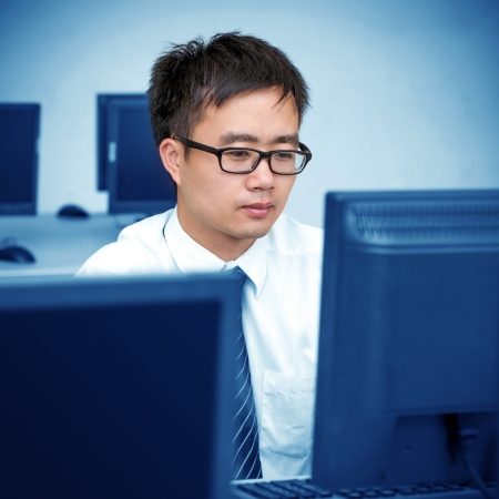 Asian man in front of the computer work photo