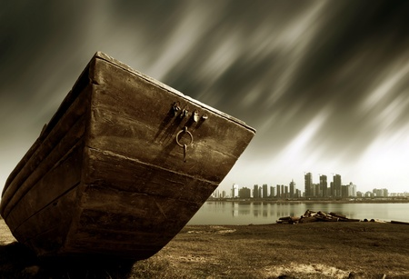 exaggerated: The other side of the city, abandoned wooden boat, urban fantasy landscape, exaggerated performance.