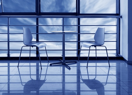roundtable: The large windows of the office, the round table and chairs. Editorial