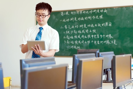 Asian male teachers are using a Tablet PC photo
