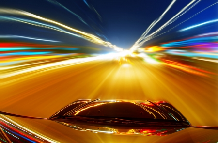 motorway: A car driving on a motorway at high speeds, overtaking other cars Stock Photo