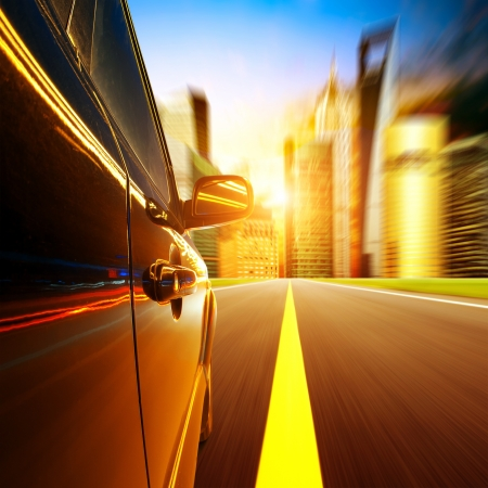 car on the road with motion blur background. photo