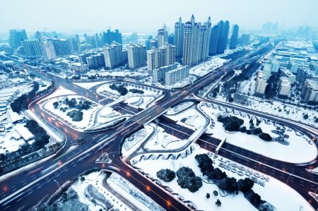 Snow, Aerial modern city highway and viaduct. Stock Photo - 17353833
