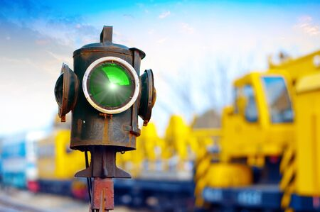 railroad station: Traffic light shows green signal on railway  Green light