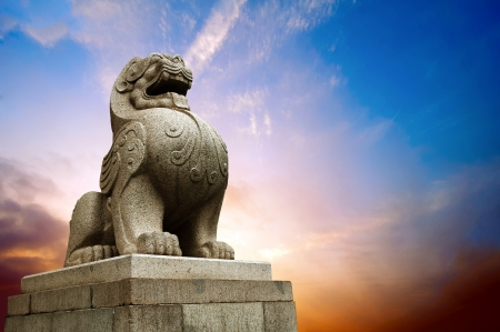 Traditional Chinese stone lions, Bund in Shanghai before the old building  Stock Photo