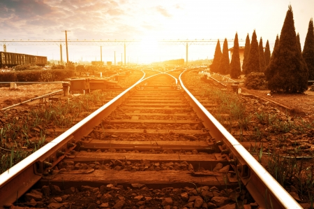 junction: Cargo train platform at sunset with container Stock Photo