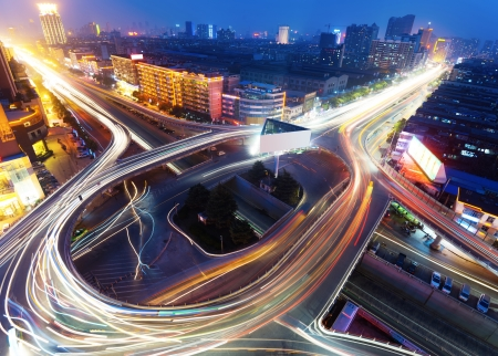 overpass: Freeway in night with cars light in modern city  Stock Photo