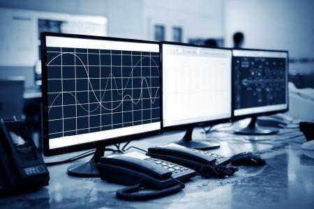 Modern plant control room and computer monitors Фото со стока