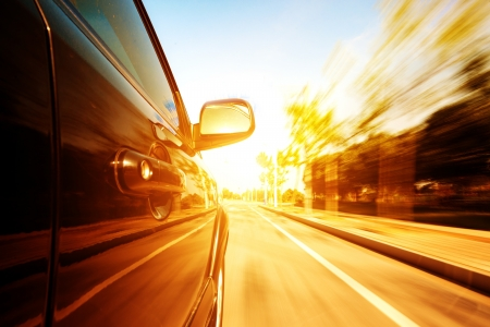 fast lane: A car driving on a motorway at high speeds, overtaking other cars Stock Photo