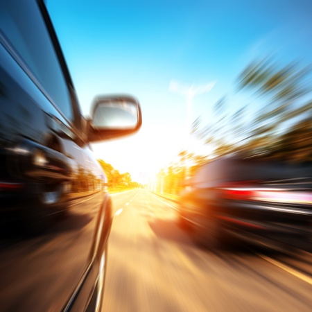 A car driving on a motorway at high speeds, overtaking other cars Stock Photo
