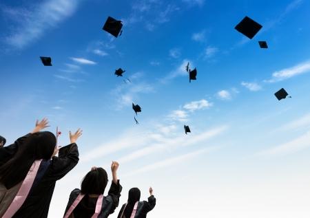 finishing school: back of chinese graduates with blue sky  Stock Photo