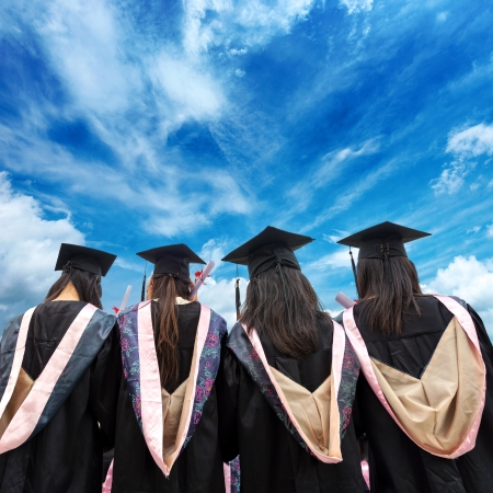 masters degree: back of chinese graduates with blue sky  Stock Photo