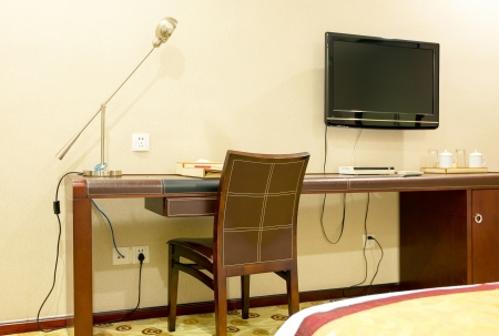 Study room with writing desk armchair and lcd tv set photo