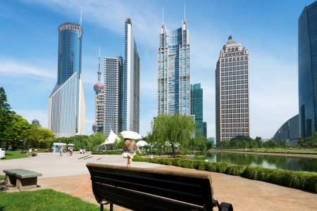 financial world: Park and modern building in Shanghai, China Editorial