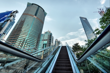 Escalator of Shanghai streets, skyscraper buildings. photo
