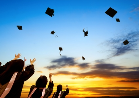 graduating: Chinese graduates and sunset sky. Stock Photo