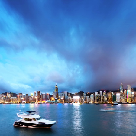 hk: Hong Kong night view of Victoria Harbor, Hong Kong Island business district. Stock Photo