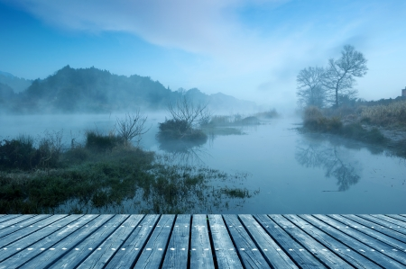 Winter morning, a mist on the lake. Stock Photo - 23049031