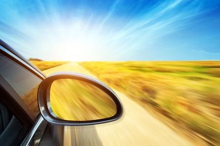 expressway: A car driving on a motorway at high speeds, overtaking other cars Stock Photo