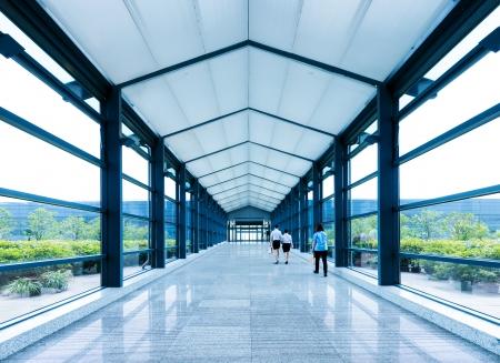 corridors: Corridors and staff, modern building interior.