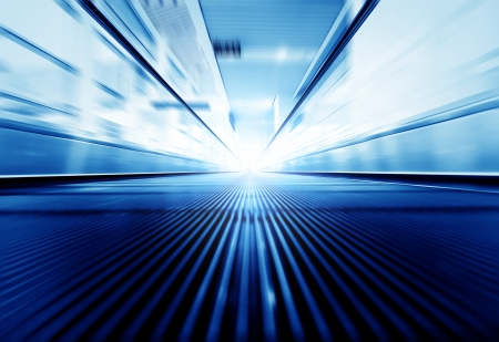moving forward: Motion of moving modern escalator way to success business