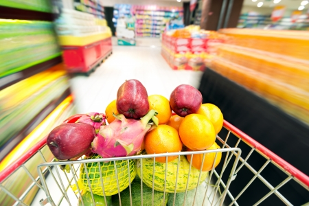 market place: Supermarket interior, filled with the fruit of the shopping cart.