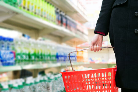 Pretty young woman buying in a supermarket/mall/gr ocery store Stock Photo - 25120464