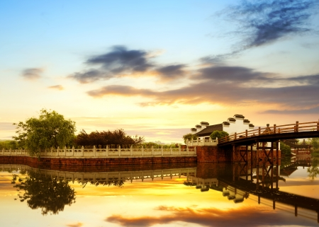 Lake of ancient Chinese architecture, dusk sky. photo