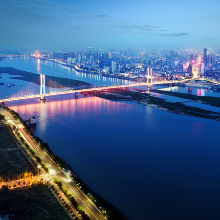 Night view of the bridge and city in shanghai china.  photo
