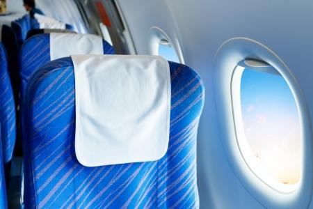 airplane window: Empty aircraft seats and windows. Stock Photo