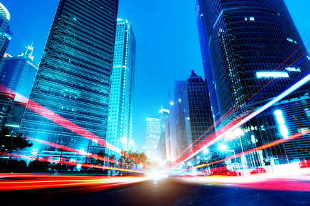 commercial architecture: The light trails on the modern building background in shanghai china. Stock Photo