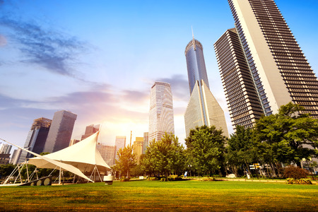 financial world: Park and modern building in Shanghai, China Stock Photo